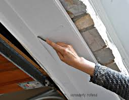 diy home maintenance garage door weather seal replacement fix
