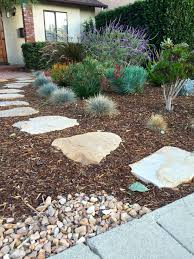 Low Maintenance looks great walkway of flagstone offset with a.