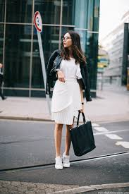 leather jacket white summer outfit daniel wellington watch street style black quilted jacket white pleated skirt with sneakers outfit street style 2