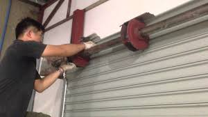 how to adjust garage door springshow to adjust spring box  YouTube