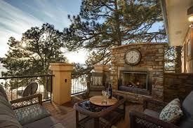 lake view deck with outdoor stone fireplace