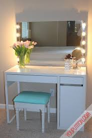 sy white polished ikea vanity desk with wall square mirror feat bulb lights as well as small teal stool as decorate women closet room decors