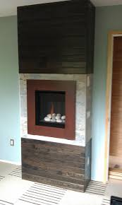 valor ledge stone fire radiant gas fireplace and insert installed with patina front in masonry fireplace in basement