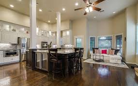 Wonderful Open Kitchen With Wood Pillars And Large Dining Island Idea
