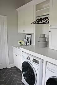 White Laundry Room with Gray Herringbone Floor Tiles