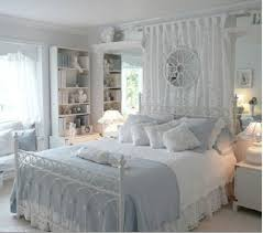 White iron bed with powder-blue and white bedding for powder-blue ...