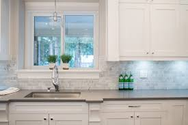 vancouver quartz countertop with square mosaic tiles kitchen contemporary and cabinetry bianco carrara marble subway tile