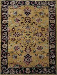 rugsville mashad gold black wool rug   rugsvillecouk