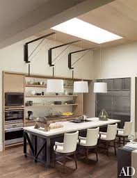 kitchen design entertaining includes: a rudin chairs line up along one end of the island in the nashville kitchen of philanthropists jennifer and billy frist the mcalpine booth amp ferrier