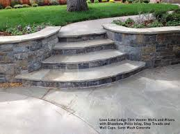 concrete wall cap loon lake ledge thin venner walls and risers with bluestone patio inlay step