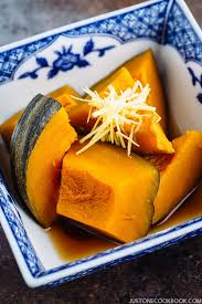 close up shot of simmered kabocha squash anese pumpkin in a anese blue willow