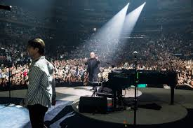 billy joel and andy cichon on stage at madison square garden in new york ny