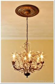 chandeliers chandelier ceiling medallion wall art sand and sisal painted medallions