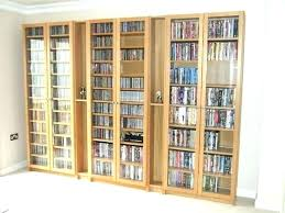 winsome wood cd dvd cabinet with glass doors antique walnut shelf interior storage ideas you had