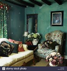 Wing Chairs For Living Room Picture On Wall Above Patterned Wing Chair In Dark Green Cottage