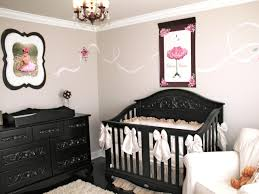 girl s pink and black nursery with wall art