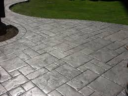 stamped concrete vs pavers what s