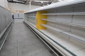 food crisis essay photos venezuelans contend food medicine photos venezuelans contend food medicine shortages as low empty refrigerator shelves are pictured at a makro