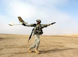member of the us army launching the raven rq 11 uas