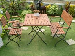 wooden garden furniture with square table and three chairs in diffe size to accentuate your garden