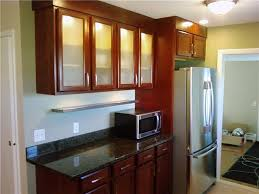 cherry kitchen cabinets with glass doors