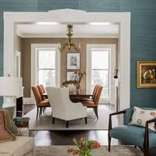 inspiration for a transitional dark wood floor dining room remodel in boston with blue walls