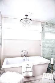 chandelier over bathtub chandelier over bathtub faux fur stool with freestanding bathtub mini chandelier over bathtub