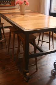 bar height dining table on 6 caster wheels with reclaimed wood surface seats 10 by salvage design pany