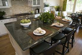 kitchen with green granite countertops and white cabinets