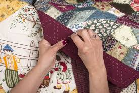 Quilting as an art form, therapy and social glue | MNN - Mother ... & Two hands making a quilt Adamdwight.com