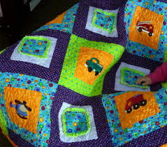 Baby Boy Quilt Patterns Ideas | HomesFeed & Fun colored quilt for baby boy with car types images Adamdwight.com