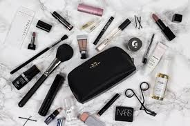 my makeup bag is usually filled to the brim with s which i regularly rotate out with new finds at the moment i m using a black leather pouch from