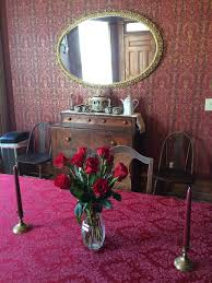 opposite the sitting room on the other side of the front hall is the library this room features a baby grand piano that jeanne s dad rescued from a