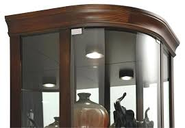 glass corner cabinets curio cabinet has halogen lighting with curved flat top corner cabinet with four adjule glass glass corner cabinets display