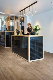 black wood reception desk with ambient lighting pure columbian oak 636m luxury vinyl tiles
