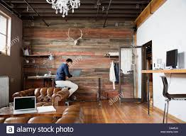 Creative office spaces Artistic Entrepreneur Working In Creative Office Space Office Furniture Entrepreneur Working In Creative Office Space Stock Photo 57884012