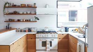Small white kitchens with white appliances White Fridge The Secret To Making White Kitchen Appliances Look Chic Architectural Digest Home Stratosphere The Secret To Making White Kitchen Appliances Look Chic
