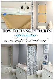 pictures and art add beauty to any room even the bathroom see how i on wall art hanging height with height measurements and how to hang pictures in a bathroom setting