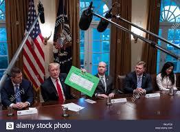 U S President Donald Trump Displays A Chart Reporting