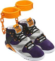 adidas shoes high tops. adidas-shoe. the js roundhouse mid, a high-top sneaker with an orange plastic cuff, was made in collaboration fashion designer jeremy scott. adidas shoes high tops