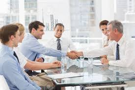 the office the meeting. Business People Making A Deal At Meeting In The Office Stock Photo - 27078490