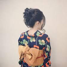 Moriyama Mamiさんのヘアスタイル お団子ヘア 黒髪 Tredina