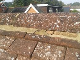 poor quality roof work on ridge tiles