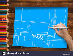 Hand Drawing Office White Lines On Blue Paper In The A Desk