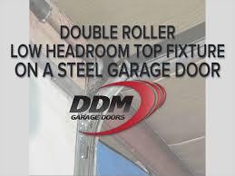 ddm garage doorsDouble Roller Low Headroom Top Fixture on a Steel Garage Door