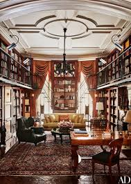 the doubleheight library in this new york city townhouse is an ode to owner andrew solomons