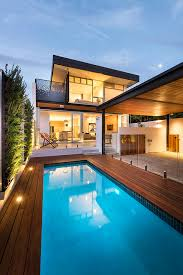Magnificent swan pool float in Landscape Modern with Carport next to