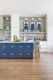 nautical kitchen with blue island and vintage swimsuits framed there are few kitchen color combinations