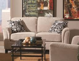 beige furniture. Comfy Fabric Beige Couch Covered Also Iron Rectangle Coffee Table Frame And Artwork Wall Portray Furniture S