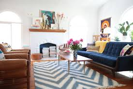 when choosing an area rug for your living room carefully consider the size of your
